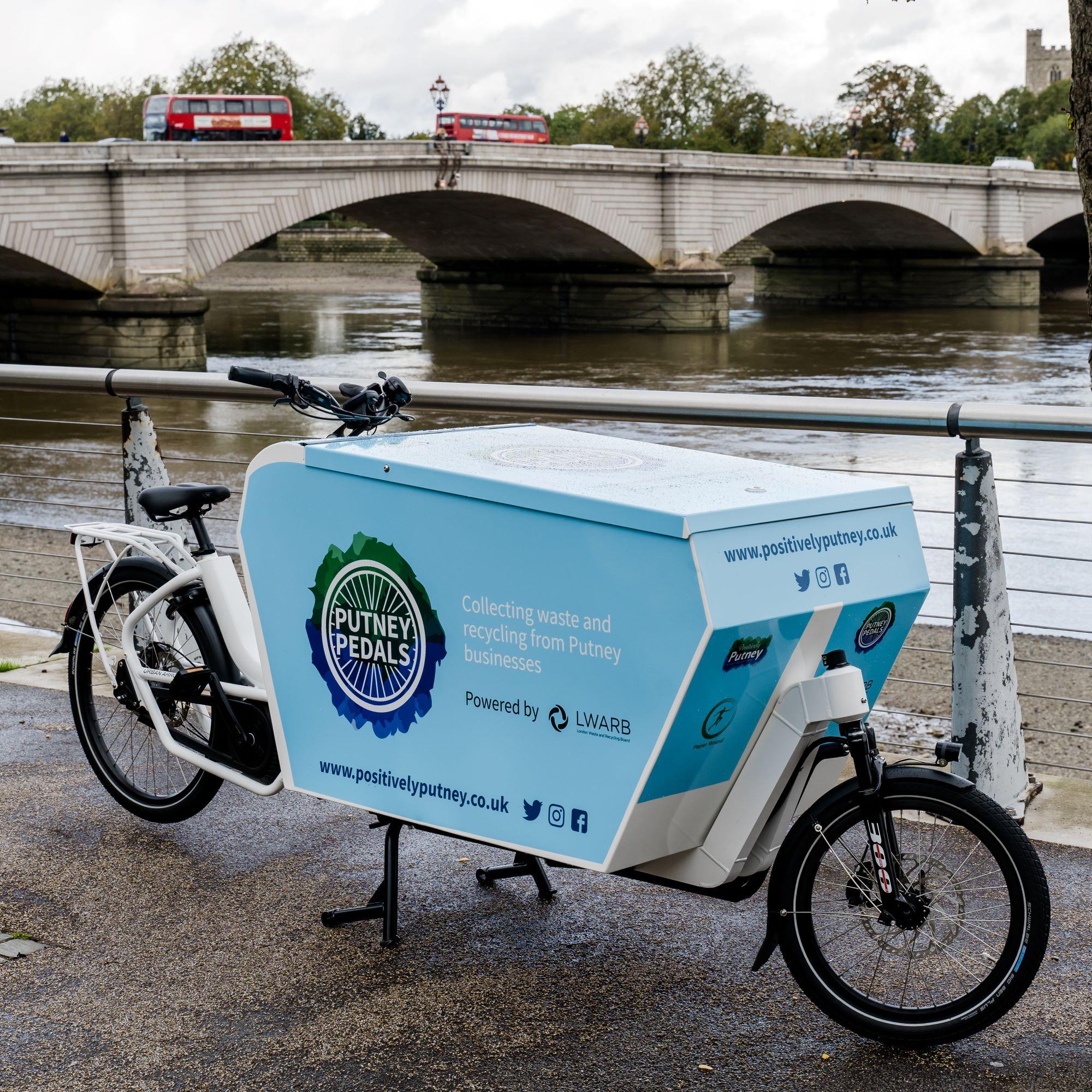 e-bike with Putney bridge